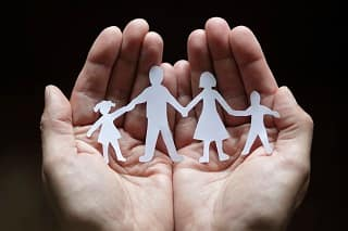 Hands holding family cutout