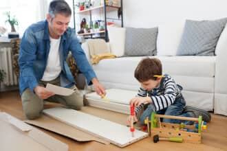 Father building furniture with son