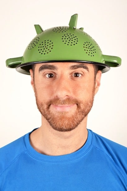 Man wearing colander on his head