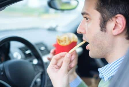Driver eating fries